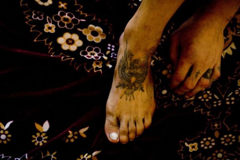 Feet criminal tattoo.